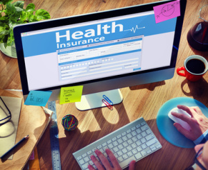 Man Working Computer Health Insurance Concepts